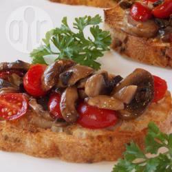 Bruschetta met tomaat en champignon recept