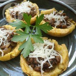 Tostones rellenos (gevulde kuipjes van bakbanaan) recept ...