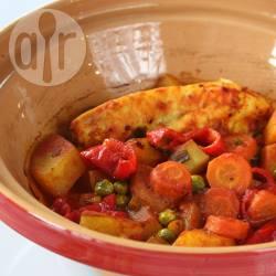 Kipstoofschotel met paprika, erwten en saffraan recept