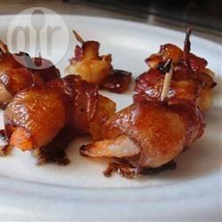 Pikant gegrilde garnalen in spek recept