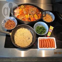 Couscous met koriander, kikkererwten, geroosterde amandelen en ...