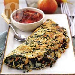 Omelet met spinazie en tomaten