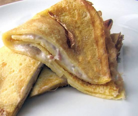 Pannenkoeken met ham, fontinakaas en bechamelsaus recept ...