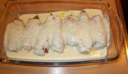 Met pecorino gegratineerde witlof in rauwe ham in heerlijke roomsaus