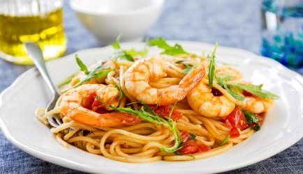 Spaghetti met scampi's en rucola recept
