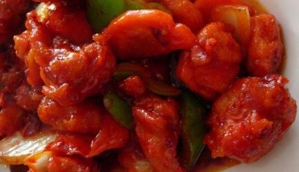 Oranje gewokte, crispy en spicy chili kip recept