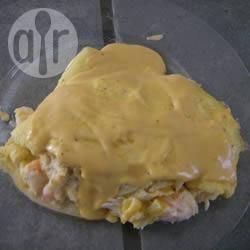 Zeevruchten omelet met romige kaassaus recept