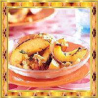 Geroosterde perziken met noten recept
