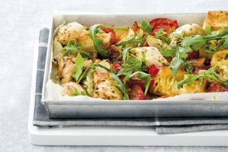 Ovenkip met tomaten en rucola