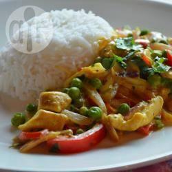 Kip kerrie met paprika en doperwten recept